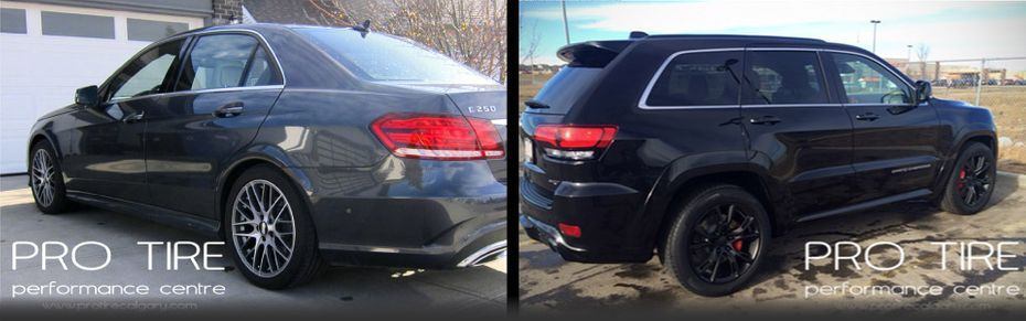 custom tires on grey sedan and black SUV