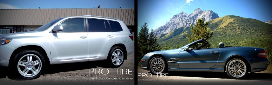 custom tires on silver SUV and blue convertible